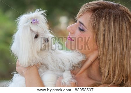 woman with cute small dog, maltese