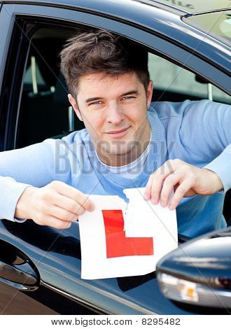 Happy Young Male Driver Tearing Up His L Sign