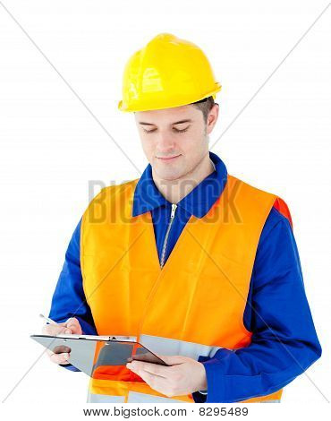 Charming Young Worker Writing On A Clipboard