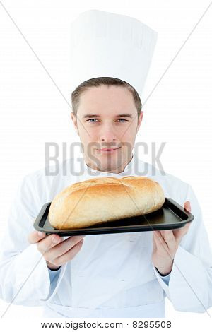Charismatic Male Cook Holding A Bread Into The Camera