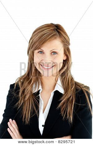Assertive Businesswoman With Folded Arms Smiling At The Camera