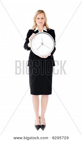 Frustrated Businesswoman Holding A Clock Against White Background