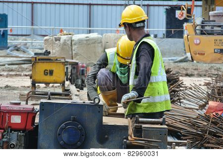 Construction workers working at the bar bending yard