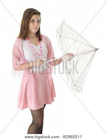 A pretty in pink teen girl opening a lacy white parasol.  On a white background.