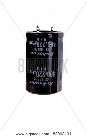 Hayward, CA - February 10, 2015: Rubycon 220 microfarad, 400 volt photo Flash electrolytic capacitor, isolated on white