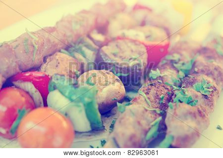 Grilled chicken hearts and vegetables, toned image