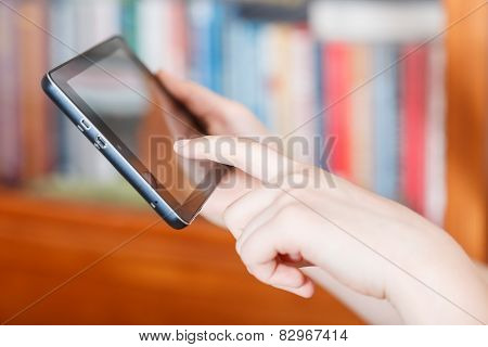 Girl Touching Tablet Pc Screen In Room