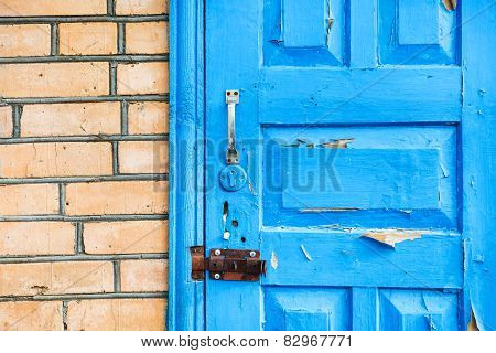 details of closed shabby blue wooden door