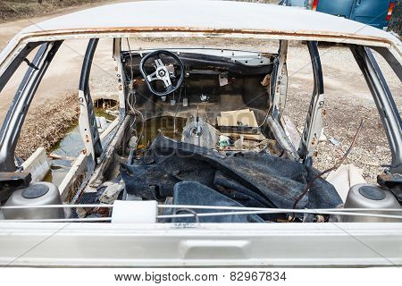 Disassembled Car At An Automobile Junkyard