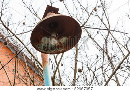 Rusty Lantern With Electric Light Bulb In Spring