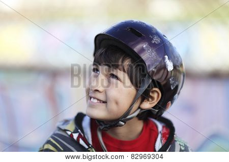 Boy in skateboard helmet