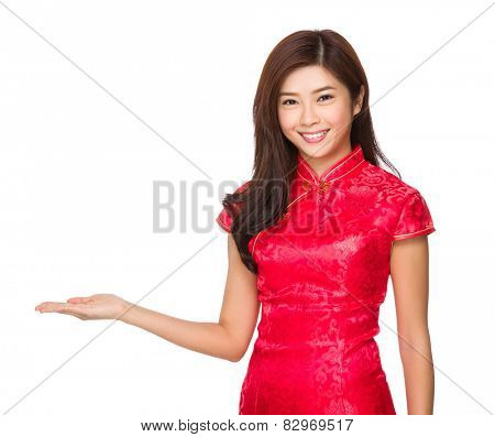 Chinese woman with cheongsam and hand presentation