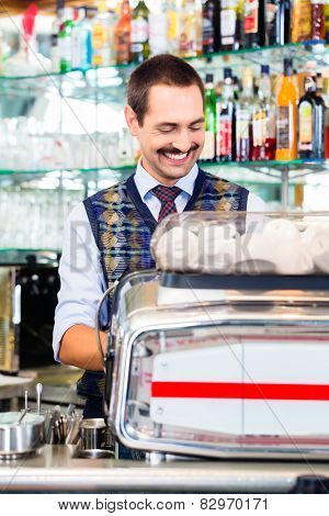 Barista preparing coffee in cafe bar using professional espresso machine