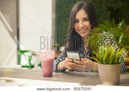 Texting In A Smoothie Shop