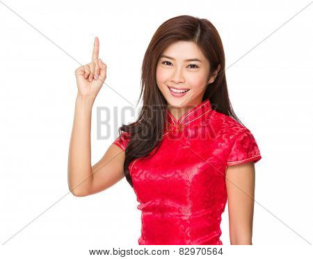Chinese woman with cheongsam and finger point upwards