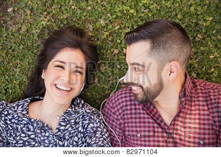 Happy Couple Relaxing At A Park