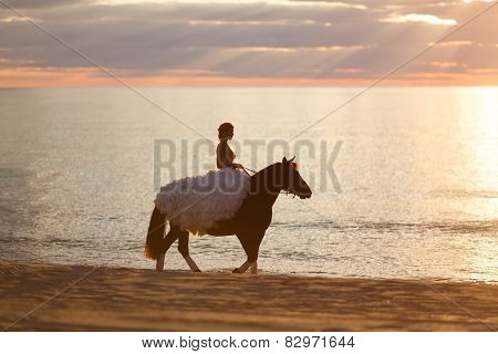 Bride On A Horse At Sunset By The Sea