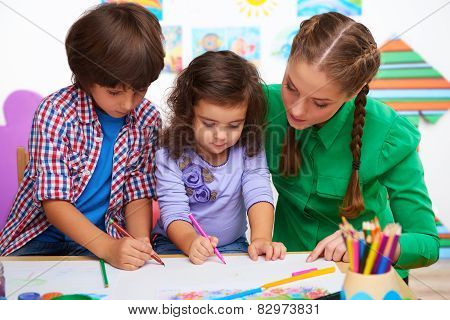 Teacher with children drawing