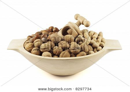 Wooden dish with nuts and nut-cracker