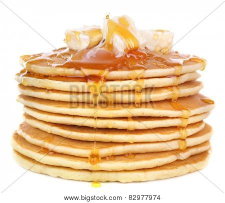 Stack of delicious pancakes with butter and honey isolated on white