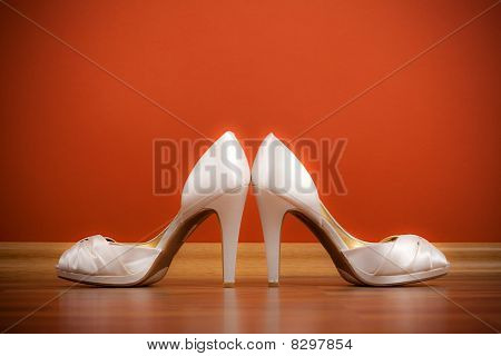 Pair Of White Female Shoes On The Floor