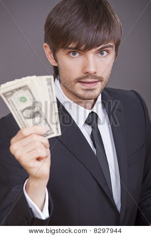 Businessman With Dollars In The Hand