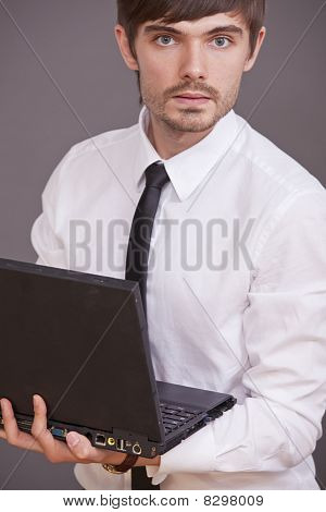 Businessman Holding Laptop Computer