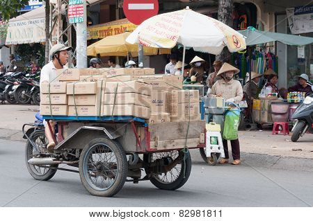Man On Motor Tricycle