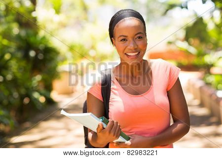 pretty female africa college student going to class