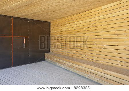 Metallic And Wooden Building Entrance With Roof