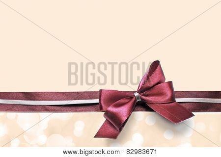Satin ribbon bow on color background