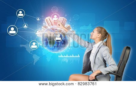 Businesswoman pressing touch screen button on virtual interface