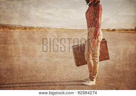 Woman With Suitcase On Road