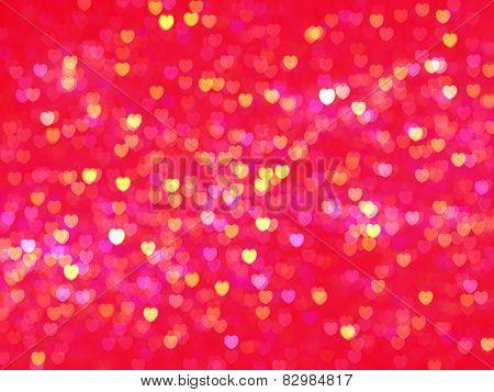 Defocused illuminate hearts background. Love background.