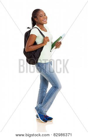 happy female African American university student holding books on white background