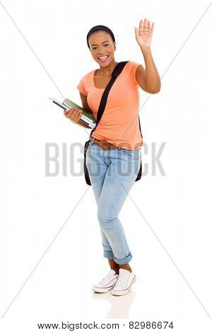 cheerful young female african american college student waving goodbye isolated on white