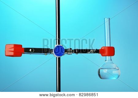Fixed test tube on support on colorful background
