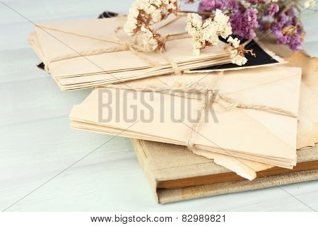 Vintage memories with dry flowers on wooden background