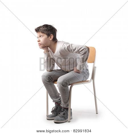 Boy sitting on a chair