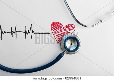 Stethoscope with heart isolated on white