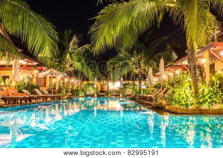 night view of beautiful swimming pool in tropical resort , Phuket, Thailand