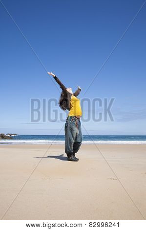 Arms Up Pregnant Woman At Beach