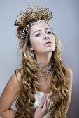 picture of snow queen  - beauty young snow queen with hair crown on her head - JPG
