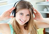 Jolly Caucasian Woman Listen To Music With Headphones