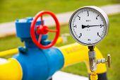 foto of air pressure gauge  - High pressure reading on a gas wellhead - JPG