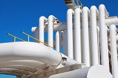 stock photo of gas-pipes  - Industrial pipe with gas and oil and water on a background of blue sky - JPG