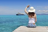 pic of say goodbye  - Woman tourist in Formentera saying boat goodbye gesture i turquoirse sea - JPG