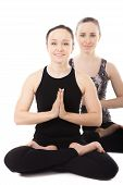 image of padmasana  - Sporty yogi female partners doing asana together fitness training yoga practice with partner sit in pose Padmasana Lotus Position palms in Namaste isolated white background - JPG