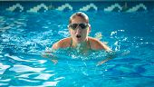 picture of breath taking  - Portrait of young swimmer woman taking a breath at swimming pool - JPG