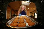 pic of wifes  - A house wife bakes cookies for her loving family - JPG